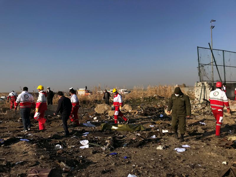Rescuers team check the debris from a plan crash belonging to Ukraine International Airlines after take-off from Iran's Imam Khomeini airport, on the outskirts of Tehran, Iran January 8, 2020. Nazanin Tabatabaee/WANA (West Asia News Agency) via REUTERS ATTENTION EDITORS - THIS IMAGE HAS BEEN SUPPLIED BY A THIRD PARTY