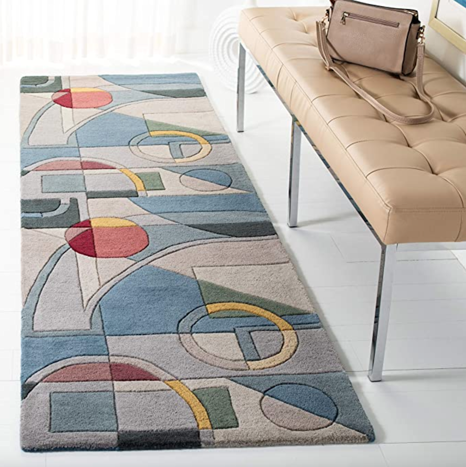 """<h3>Abstract Wool Rug Runner</h3><br>Upgrade your unsightly bare floors with this statement-making handmade wool runner.<br><br><strong>Safavieh</strong> Mid-Century Abstract Wool Runner, $, available at <a href=""""https://amzn.to/3z6Iv6q"""" rel=""""nofollow noopener"""" target=""""_blank"""" data-ylk=""""slk:Amazon"""" class=""""link rapid-noclick-resp"""">Amazon</a>"""