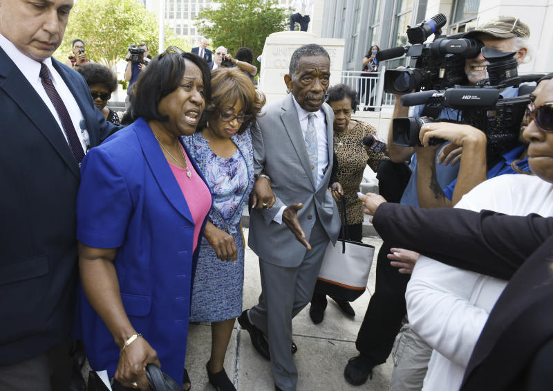 Former U.S. Rep. Corrine Brown, third from left, leaves the courthouse on Thursday, May 11, 2017, in Jacksonville, Fla., after being found of taking money from a charity that was purported to be giving scholarships to poor students. (Bob Self/The Florida Times-Union via AP)
