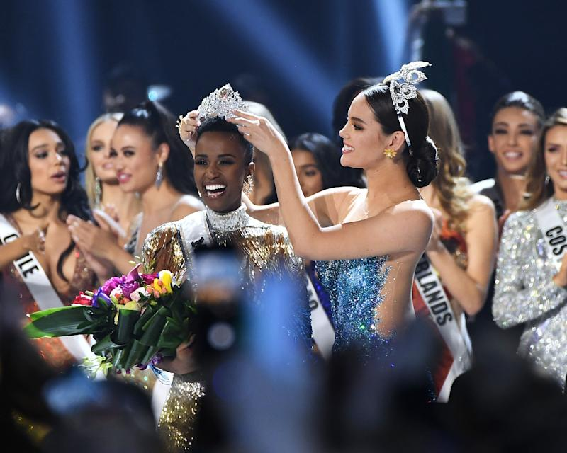 Miss Universe 2019 Zozibini Tunzi, of South Africa, is crowned onstage by Miss Universe 2018 Catriona Gray at the 2019 Miss Universe Pageant at Tyler Perry Studios.  (Photo: Paras Griffin via Getty Images)