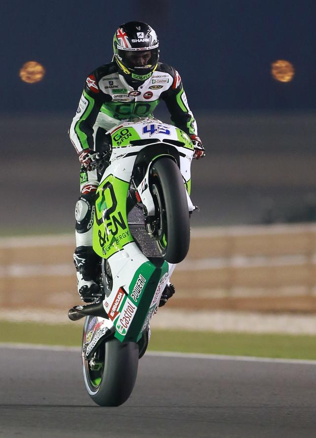 Honda Gresini MotoGP rider Scott Redding of Britain rides his bike during a free practice session at the MotoGP World Championship at the Losail International circuit in Doha March 20, 2014. REUTERS/Mohammed Dabbous (QATAR - Tags: SPORT MOTORSPORT)