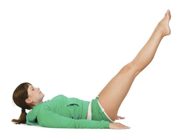 <b>Straight Leg Lift</b> <br> Lie down straight on your back, on a yoga mat. Place a thin book or other block between your inner thighs. Now, slowly, bring your legs straight up, with the feet pointing toward the ceiling, and without the knees bending. Keeping the back pressed to the ground, maintain this position for a few seconds, before bringing the legs down without bending. Repeat.