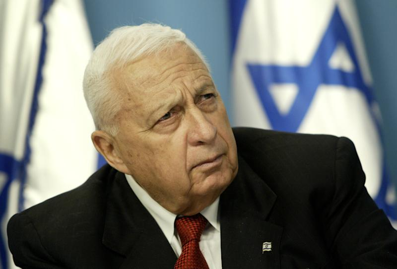 FILE -- In this Sunday May 16, 2004 file photo, Israeli Prime Minister Ariel Sharon pauses during a news conference in his Jerusalem office regarding education reform. On Wednesday, Jan. 1, 2014 the condition of the comatose former Israeli Prime Minister Ariel Sharon has taken a turn for the worse, the hospital treating him said Wednesday. Sharon, 85, has been in a coma since 2006 when a devastating stroke incapacitated him at the height of his political power. (AP Photo/Oded Balilty, File)