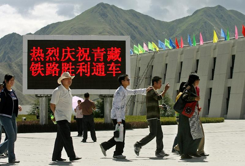 A group of local residents arrive to take a look at the newly opened Lhasa train station, in Tibet, in 2006 (AFP Photo/Mark Ralston)