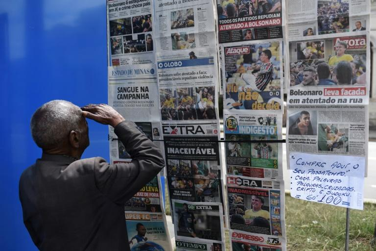 A man looks at the front pages of newspapers about the attack against Brazilian presidential candidate Jair Bolsonaro