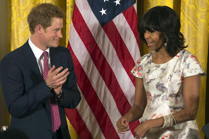 FILE - In this May 9, 2013 file photo, first lady Michelle Obama speaks during an unannounced visit from Prince Harry at an event in honor of military mothers in the East Room of the White House in Washington. By reaching beyond the pair of relatively safe issues she has pushed _ reducing childhood obesity and rallying public support for military families _ the Harvard-trained lawyer who some say has played it safe is showing a willingness to step outside of her comfort zone. (AP Photo/Jacquelyn Martin, File)