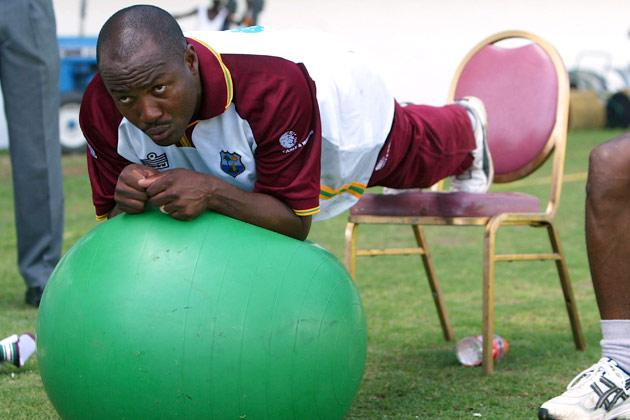 KINGSTON, JAMAICA - MARCH 10: West Indies Captain Brian Lara balancing on exercise ball during the West Indies net practice at the Sabina Park Cricket Ground, on March 10  2004, in Kingston, Jamaica. (Photo by Ben Radford/Getty Images)