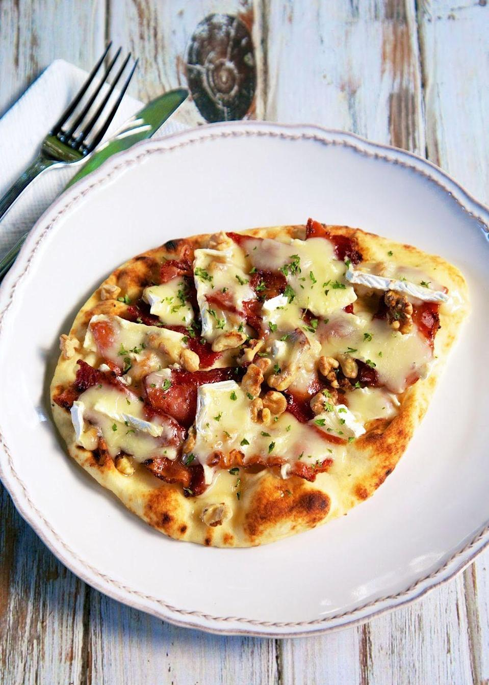"""<p>This flatbread is a total blend of sweet, salty, crunchy, and creamy.</p><p>Get the recipe at <a href=""""http://www.plainchicken.com/2014/11/honey-bacon-brie-walnut-flatbread.html"""" rel=""""nofollow noopener"""" target=""""_blank"""" data-ylk=""""slk:Plain Chicken"""" class=""""link rapid-noclick-resp"""">Plain Chicken</a>.</p>"""