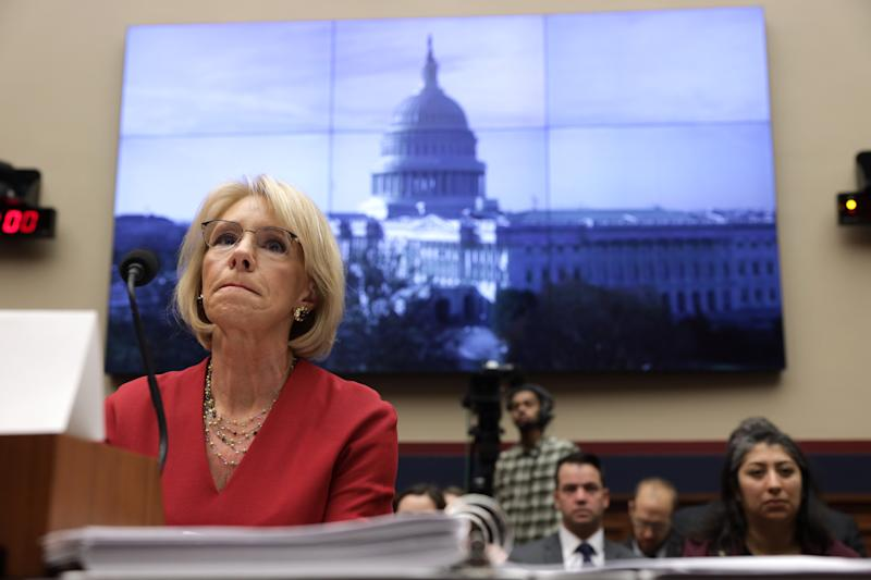 "WASHINGTON, DC - DECEMBER 12: U.S. Secretary of Education Betsy DeVos testifies during a hearing before House Education and Labor Committee December 12, 2019 on Capitol Hill in Washington, DC. The committee held a hearing on ""Examining the Education Department's Implementation of Borrower Defense."" (Photo by Alex Wong/Getty Images)"