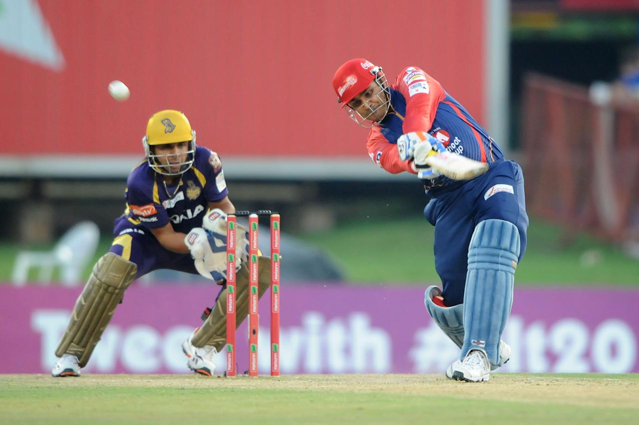 PRETORIA, SOUTH AFRCA - OCTOBER 13:  Virender Sehwag (R) of the Daredevils bats as wicketkeeper Manvinder Bisla looks on during the Karbonn Smart CLT20 Group A match between Kolkata Knight Riders (IPL) and Delhi Daredevils (IPL) at SuperSport Park on October 13, 2012 in Pretoria, South Africa.  (Photo by Lee Warren/Gallo Images/Getty Images)