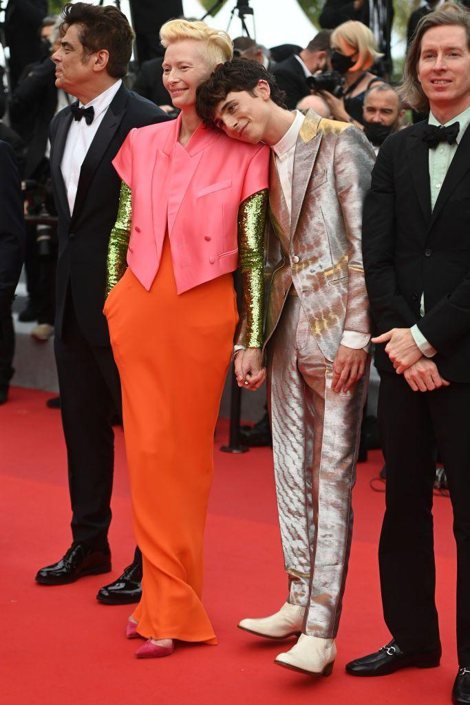 <p>The French Dispatch co-stars posed together at the premiere for their Wes Anderson movie.</p><p>Seen resting his head on Swinton at one point - and winning over the internet in the process - Chalamet was dressed head-to-toe in Tom Ford, wearing a silver jacquard tuxedo suit and cream Chelsea boots. Swinton opted for a coral pink short-sleeved jacket over brass-look sleeves paired with orange trousers.</p>