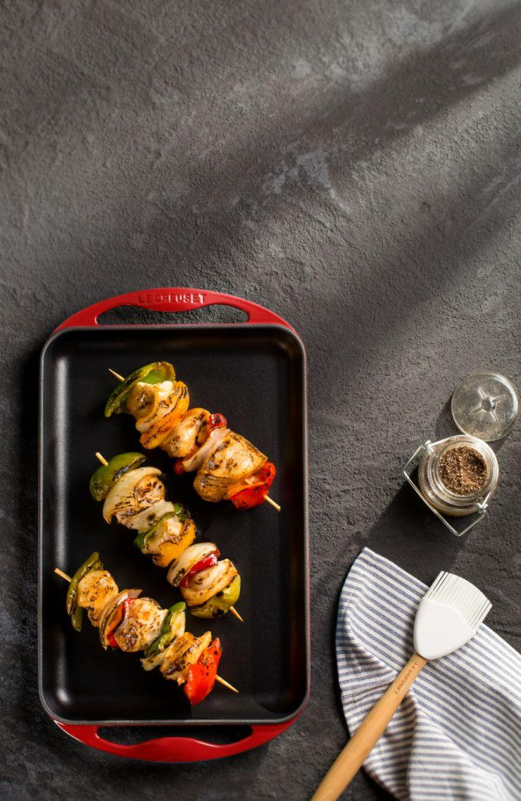 """Get grilling (and grill marks) with this cast iron pan from Le Creuset. It features oversized ergonomic handles that are easy to hold and is dishwasher-, oven- and broiler-safe.<a href=""""https://fave.co/351NEz7"""" target=""""_blank"""" rel=""""noopener noreferrer"""">Originally $170, get it now for $80 at Nordstrom</a>."""
