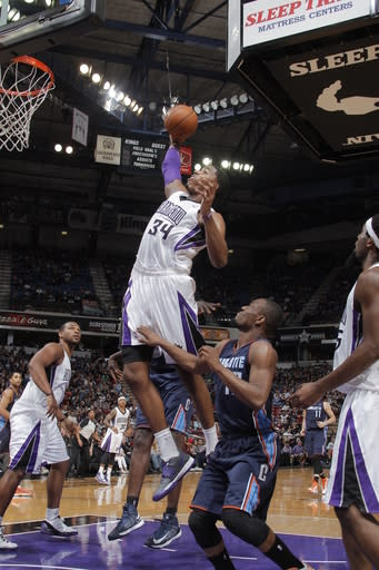 SACRAMENTO, CA - MARCH 3: Jason Thompson #34 of the Sacramento Kings rebounds the ball against the Charlotte Bobcats on March 3, 2013 at Sleep Train Arena in Sacramento, California. (Photo by Rocky Widner/NBAE via Getty Images)