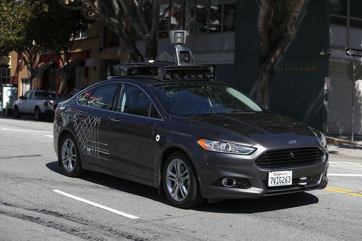 Self-driving Uber hits, kills pedestrian