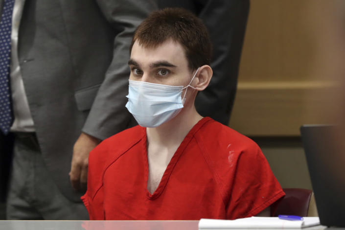 Parkland school shooter Nikolas Cruz sits in court during a pre-trial hearing at the Broward County Courthouse in Fort Lauderdale, Fla., Wednesday, July 14, 2021, on four criminal counts stemming from his alleged attack on a Broward jail guard in November 2018. Cruz is accused of punching Sgt. Ray Beltran, wrestling him to the ground and taking his stun gun. (Amy Beth Bennett/South Florida Sun-Sentinel via AP, Pool)