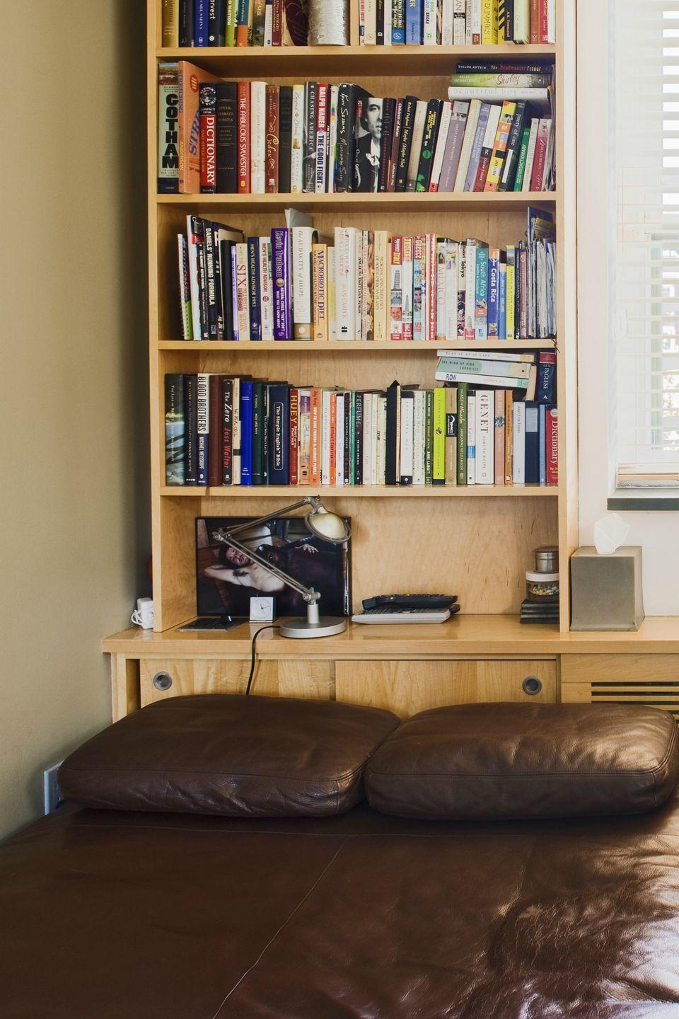 """<p>Corral an unwieldy bedroom reading pile with a small bookshelf next to your nightstand so you can <a href=""""https://www.womansday.com/life/entertainment/g25322040/best-nonfiction-books-2019/"""" rel=""""nofollow noopener"""" target=""""_blank"""" data-ylk=""""slk:read all night long"""" class=""""link rapid-noclick-resp"""">read all night long</a>.</p><p><strong><a class=""""link rapid-noclick-resp"""" href=""""https://www.amazon.com/Rerii-Composite-Standing-Organizer-Bookshelf/dp/B07D321981/?tag=syn-yahoo-20&ascsubtag=%5Bartid%7C10070.g.3310%5Bsrc%7Cyahoo-us"""" rel=""""nofollow noopener"""" target=""""_blank"""" data-ylk=""""slk:SHOP SMALL BOOKSHELVES"""">SHOP SMALL BOOKSHELVES</a></strong></p>"""