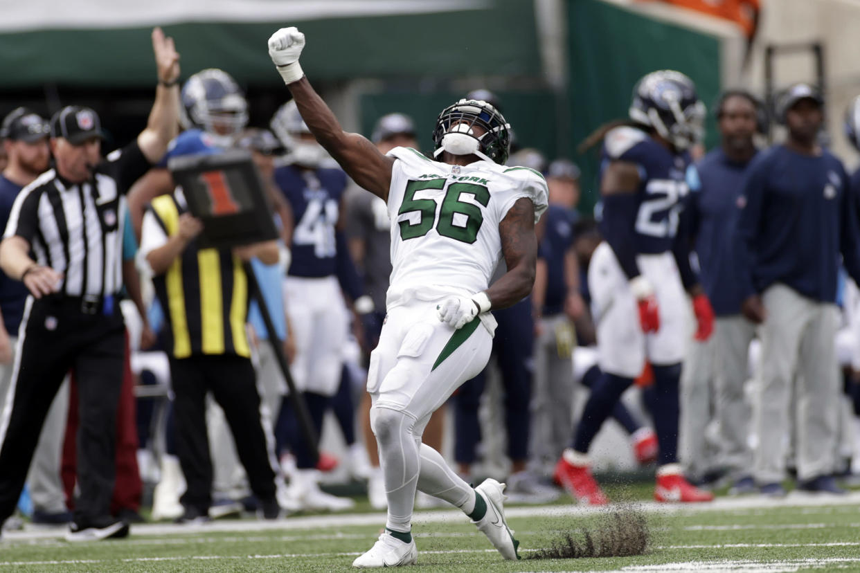 New York Jets outside linebacker Quincy Williams (56) reacts against the Tennessee Titans during an NFL football game, Sunday, Oct. 3, 2021, in East Rutherford, N.J. (AP Photo/Adam Hunger)