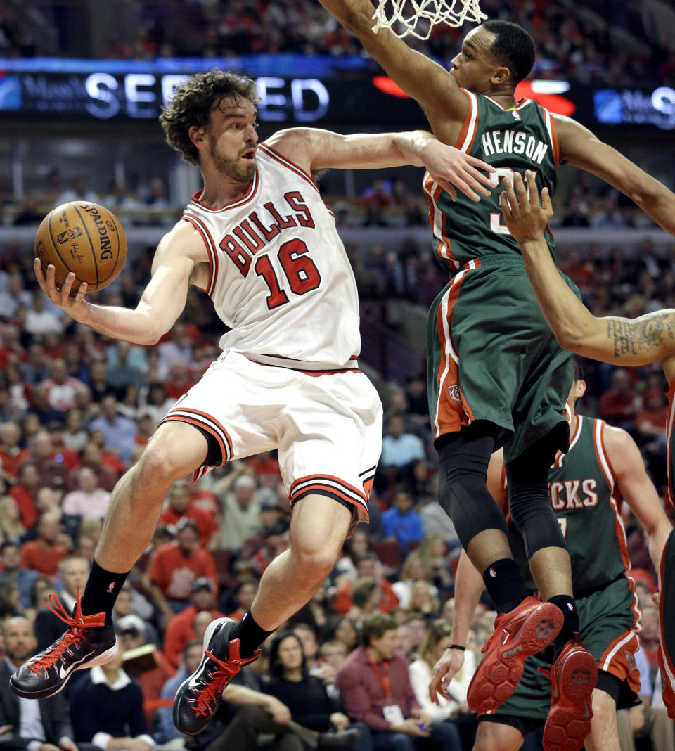 FILE - Chicago Bulls forward Pau Gasol, left, looks to a pass against the Milwaukee Bucks during the second half in Game 1 of the NBA basketball playoffs in Chicago, in this Saturday, April 18, 2015, file photo. Pau Gasol announced his retirement from basketball on Tuesday, Oct. 5, 2021, ending a career that lasted more than two decades and earned him two NBA titles and a world championship gold with Spain's national team. (AP Photo/Nam Y. Huh, File)