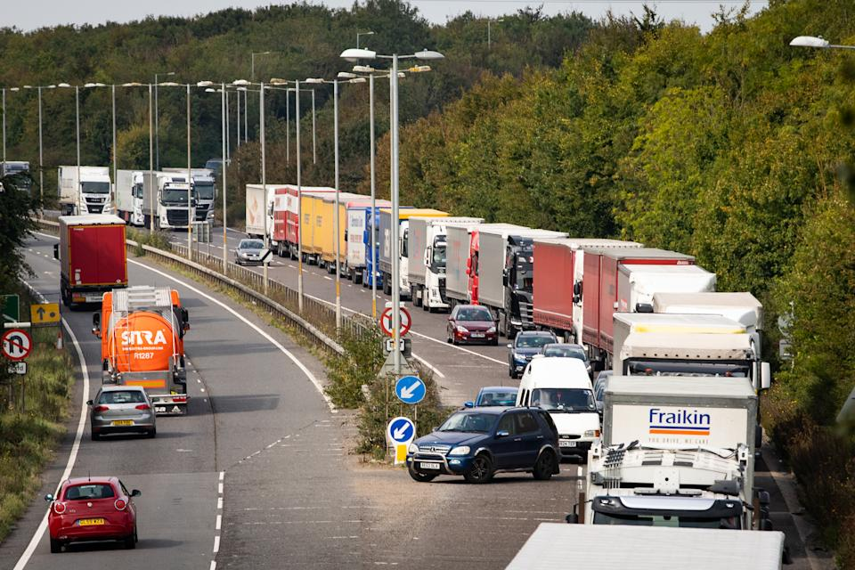 Lorries queue on the A2 near Dover in Kent. Credit: Getty.