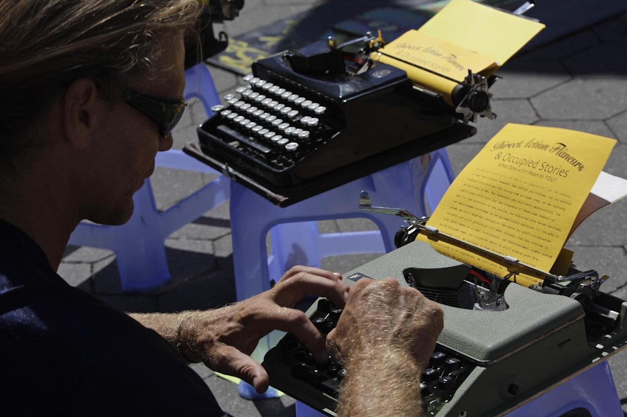 Barry Knight an activist associated with the Occupy DC movement uses an old fashion typewriter to tell his story during a gathering of the Occupy Wall Street movement in Washington Square park, Saturday, Sept. 15, 2012 in New York. The Occupy Wall Street movement will mark it's first anniversary on Monday. (AP Photo/Mary Altaffer)