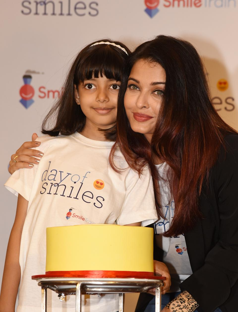 Indian Bollywood actress Aishwarya Rai Bachchan (R) poses with her daughter Aaradhya Bachchan during a birthday event with NGO Smile Train India in honour of her late father, Krishnaraj Rai, in Mumbai on November 20, 2018. - The Smile Train non-profit provides corrective surgery for children born with cleft lips and palates. (Photo by - / AFP)        (Photo credit should read -/AFP via Getty Images)