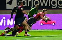 Toulon's Lachlan Turner jumps to score a try during their French Top 14 rugby union match against Stade Francais, at the Jean Bouin stadium in Paris, on September 6, 2015 (AFP Photo/Loic Venance)