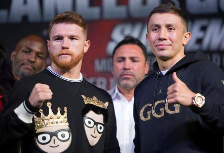 FILE PHOTO: Middleweight boxer Canelo Alvarez of Mexico and WBC/WBA/IBF middleweight champion Gennady Golovkin of Kazakhstan pose during a news conference at MGM Grand hotel and casino in Las Vegas, Nevada, U.S., September 13, 2017. REUTERS/Las Vegas Sun/Steve Marcus/File Photo