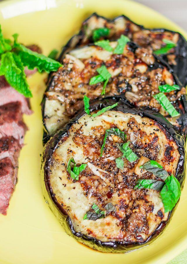 """<p>Serve this eggplant with a juicy steak or on its own. </p><p><strong>Get the recipe at <a href=""""https://www.jocooks.com/main-courses/grilled-eggplant-with-garlic-sauce-and-mint/"""" rel=""""nofollow noopener"""" target=""""_blank"""" data-ylk=""""slk:Jo Cooks"""" class=""""link rapid-noclick-resp"""">Jo Cooks</a>.</strong></p><p><strong><strong><strong><strong><a class=""""link rapid-noclick-resp"""" href=""""https://go.redirectingat.com?id=74968X1596630&url=https%3A%2F%2Fwww.walmart.com%2Fip%2FPioneer-Woman-Slotted-Turner%2F910200136&sref=https%3A%2F%2Fwww.thepioneerwoman.com%2Ffood-cooking%2Fmeals-menus%2Fg32188535%2Fbest-grilling-recipes%2F"""" rel=""""nofollow noopener"""" target=""""_blank"""" data-ylk=""""slk:SHOP KITCHEN TOOLS"""">SHOP KITCHEN TOOLS</a></strong></strong></strong></strong></p>"""