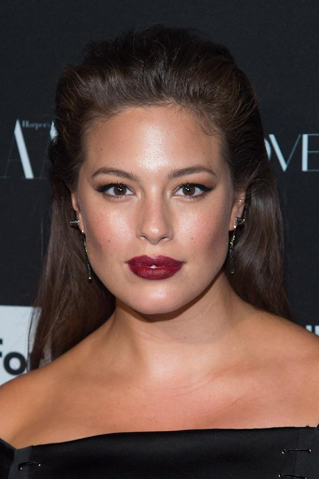 "<p>For a 2015 <strong>Harper's Bazaar</strong> event, Graham chose a bold, <a href=""https://www.popsugar.com/beauty/Best-Lipsticks-2019-45664445"" class=""ga-track"" data-ga-category=""Related"" data-ga-label=""http://www.popsugar.com/beauty/Best-Lipsticks-2019-45664445"" data-ga-action=""In-Line Links"">deep berry-colored lipstick</a> to make a statement, while keeping the rest of her makeup (and hair) fairly simple.</p>"