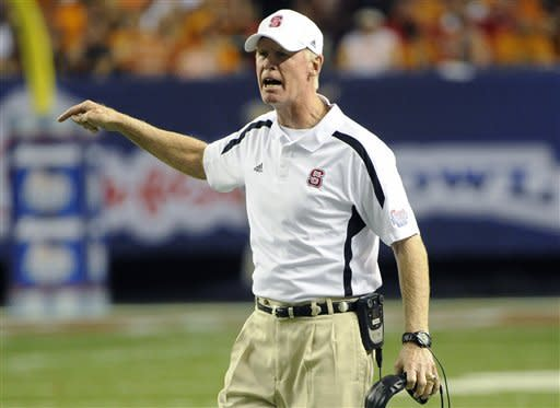 North Carolina State head coach Tom O'Brien reacts on the sidelines as his teams plays Tennessee in Chick-fil-A Kickoff Game, beginning the NCAA college football season, in Atlanta., on Friday, Aug. 31, 2012. (AP Photo/John Amis)