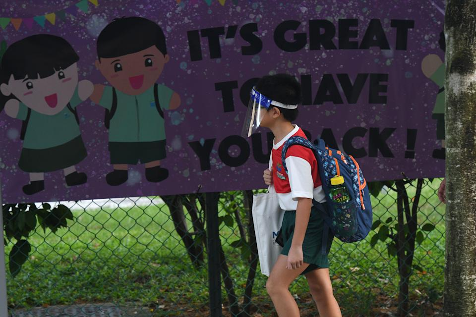 SINGAPORE, June 2, 2020  -- A primary school student wearing a face shield arrives at school in Singapore on June 2, 2020. Schools in Singapore reopened on Tuesday as the state embarked on a phased reopening from a COVID-19