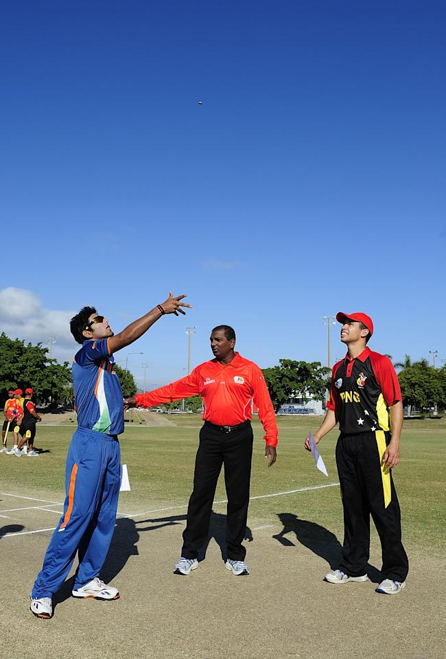 TOWNSVILLE, AUSTRALIA - AUGUST 16:  Unmukt Chand of India and Chris Nauwe Kent of Papua New Guinea toss the coin before the start of the ICC U19 Cricket World Cup 2012 match between India and PNG at Endeavour Park on August 16, 2012 in Townsville, Australia.  (Photo by Ian Hitchcock-ICC/Getty Images)