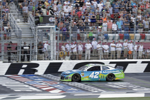 Kyle Larson takes the checkered flag to win the final segment of the NASCAR All-Star Open auto race at Charlotte Motor Speedway in Concord, N.C., Saturday, May 18, 2019. Larsen moved on to the All-Star Race with the win. (AP Photo/Chuck Burton)