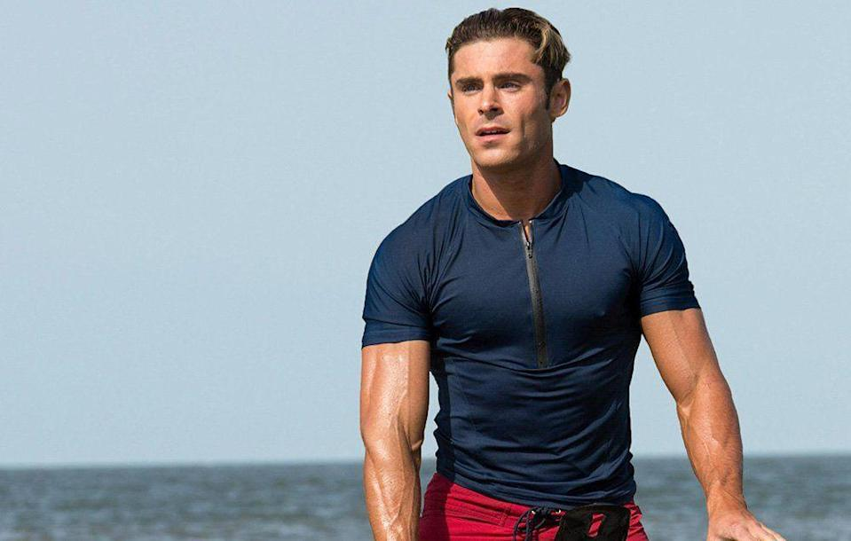 <p>A slicked back, just got out of the water hairstyle (and an extremely chiseled physique) did wonders for Efron's persona of a beach lifeguard in <em>Baywatch</em>. </p>