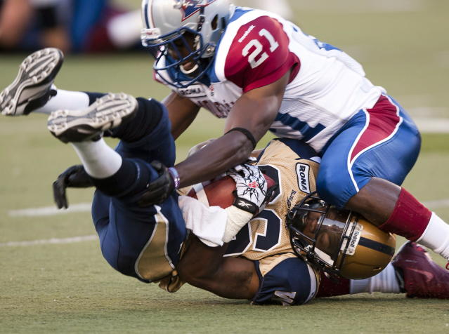 Montreal Alouettes Wopamo Osaisai(21) tackles Winnipeg Blue Bombers Jeremy Blount during first quarter Canadian Football League pre-season action Thursday, June 14, 2012 in Montreal. THE CANADIAN PRESS/Ryan Remiorz