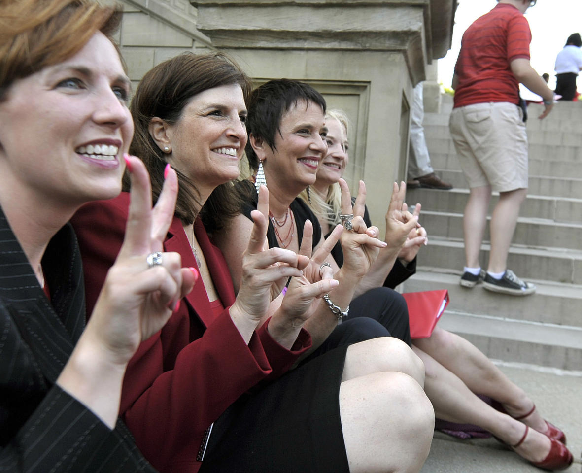 "Rep. Barb Byrum, D-Onondaga, from left, Rep. Lisa Brown, D-West Bloomfield, playwright Eve Ensler and Sen. Rebecca Warren, D-Ann Arbor, pose for a group picture during an event including a performance of ""The Vagina Monologues"" by Brown and 10 other lawmakers on the Michigan Statehouse steps, Monday, June 18, 2012, in Lansing, Mich. Brown, who says she was barred from speaking in the Michigan House because Republicans objected to her saying ""vagina"" during debate over anti-abortion legislation, performed ""The Vagina Monologues"" with a hand from the author Eve Ensler. (AP Photo/Detroit News, Dale G. Young)"