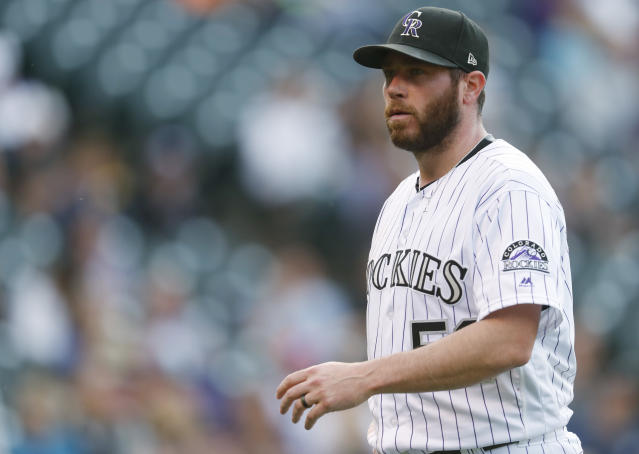FILE - In this Sept. 17, 2017, file photo, Colorado Rockies relief pitcher Greg Holland heads back to the dugout after giving up the go-ahead run to the San Diego Padres in the ninth inning of a baseball game, in Denver. In a historically slow market, players and management are feuding publicly about riches and rules, and teams seemingly are seeking bargains like shoppers awaiting a closeout. Job-seekers include pitchers Alex Cobb and Lance Lynn; reliever Greg Holland; infielder Eduardo Nunez; outfielders Carlos Gomez and Carlos Gonzalez; and catcher Jonathan Lucroy. (AP Photo/David Zalubowski, File)