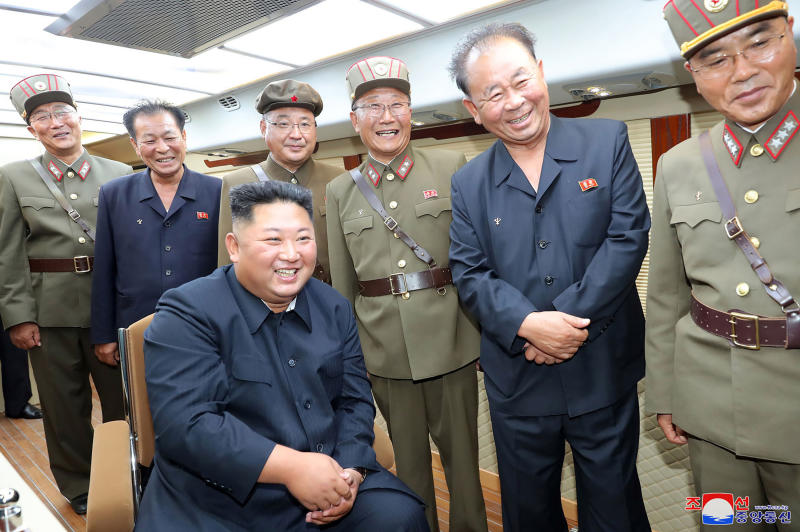 "In this Saturday, Aug. 10, 2019, photo provided by the North Korean government, North Korean leader Kim Jong Un, sitting, watches test firings of short-range weapons at an undisclosed location in North Korea. North Korea on Saturday extended a recent streak of weapons displays by firing what appeared to be two short-range ballistic missiles into the sea, according to South Korea's military. The content of this image is as provided and cannot be independently verified. Korean language watermark on image as provided by source reads: ""KCNA"" which is the abbreviation for Korean Central News Agency. (Korean Central News Agency/Korea News Service via AP)"