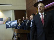 Special Agent in Charge Aaron Rouse of the FBI Las Vegas Field Office leaves the podium after a news conference at the FBI Las Vegas Field Office, Wednesday, July 14, 2021, in Las Vegas. U.S. officials declared they dismantled a key international cocaine and money-laundering hub in an ongoing investigation that began in Las Vegas and has involved at least 30 other countries. The top federal prosecutor and FBI chief in Las Vegas said the recent arrests of six people in Nevada, Arizona, California and Washington state came as part of the six-year probe. (Bizuayehu Tesfaye/Las Vegas Review-Journal via AP)