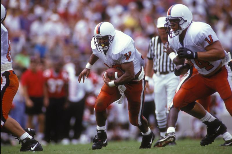 COLLEGE PARK, MD - SEPTMEBR 1: Charles Way #30 of the Virginia Cavaliers runs with the ball during a college football game against the Maryland Terrapins on September 1, 1993 at Byrd Stadium in College Park, Maryland. (Photo by Mitchell Layton/Getty Images)