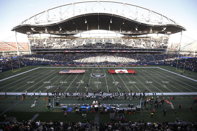 U.S. and Canadian flags are presented on the field before an NFL preseason football game between the Green Bay Packers and the Oakland Raiders on Thursday, Aug. 22, 2019, in Winnipeg, Manitoba. (John Woods/The Canadian Press via AP)