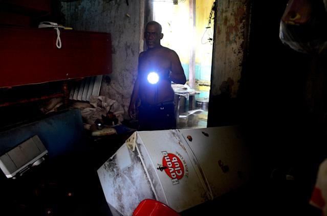 <p>A Cuban with a lantern in a flooded house in downtown Havana, on Sept. 10, 2017.<br> (Photo: Abel Ernesto/AFP/Getty Images) </p>