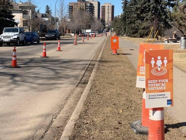 A stretch of Saskatchewan Drive was converted into a mobility lane last summer. The Street Labs project aims to test ideas like this to make streets safer for communities.  (Natasha Riebe/CBC - image credit)
