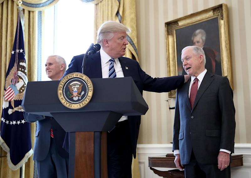 Donald Trump with Jeff Sessions before the US Attorney General's swearing in ceremony last month: Getty