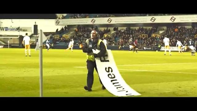 ​Millwall have, for some reason, produced a rather dramatic video of one of the club's stewards embarrassing himself whilst attempting to remove a stray sponsor board from the pitch during their 2-1 victory over Sheffield Wednesday on Tuesday night. The win hoisted Millwall up to 11th in the Championship, and the club were obviously in a playful mood as they decided to poke fun at the poor fellow simply trying to do his job. Emphasis on the 'trying'. You can see the oddly overproduced video...