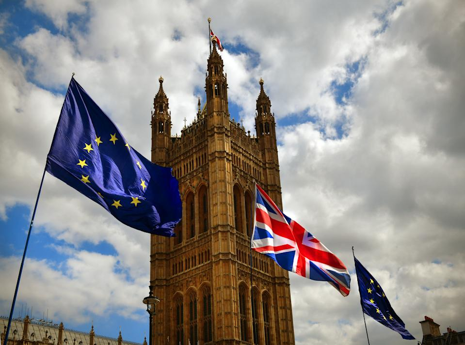 The European Union and UK flags flying outside the House of Parliament in London as part of a Brexit protest