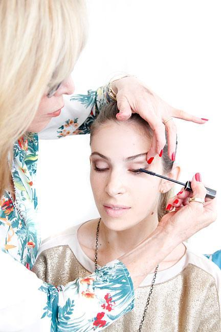 """<div class=""""caption-credit""""> Photo by: Photo: Kelly Stuart</div><div class=""""caption-title"""">Apply Mascara</div>""""Mascara also brings out your eyes. Instead of the using the whole wand, I just use the tip, separating lashes as I go,"""" says Linter. """"This way, I don't apply too much mascara at once and lashes don't get stuck together."""" <br> <br> <b>MORE <br> <a rel=""""nofollow noopener"""" href=""""http://www.elle.com/beauty/makeup-skin-care/bright-nail-polish-colors?link=emb&dom=yah_life&src=syn&con=blog_elle&mag=elm"""" target=""""_blank"""" data-ylk=""""slk:The Top Manicure Color for Your Skin Tone"""" class=""""link rapid-noclick-resp"""">The Top Manicure Color for Your Skin Tone</a> <br> <a rel=""""nofollow noopener"""" href=""""http://www.elle.com/beauty/the-look-summer-hairstyles-657514?link=emb&dom=yah_life&src=syn&con=blog_elle&mag=elm"""" target=""""_blank"""" data-ylk=""""slk:Most Wanted Celebrity Hairstyles for Summer"""" class=""""link rapid-noclick-resp"""">Most Wanted Celebrity Hairstyles for Summer</a></b> <br>"""