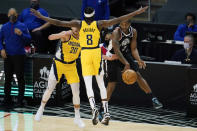 Los Angeles Clippers forward Kawhi Leonard (2) passes the ball against Indiana Pacers forward Doug McDermott (20) and guard Justin Holiday (8) during the first quarter of an NBA basketball game, Sunday, Jan. 17, 2021, in Los Angeles. (AP Photo/Ashley Landis)
