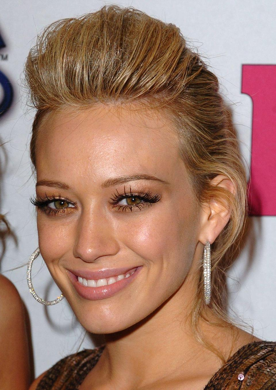 <p>This coiffed pony was a Hilary Duff staple during the mid-2000s — and based off of looks alone we assume it required large amounts of hair gel to achieve. </p>