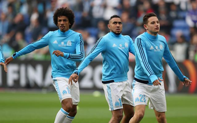 Soccer Football - Europa League Final - Olympique de Marseille vs Atletico Madrid - Groupama Stadium, Lyon, France - May 16, 2018 (L - R) Marseille's Luiz Gustavo, Dimitri Payet and Florian Thauvin during the warm up before the match REUTERS/Peter Cziborra